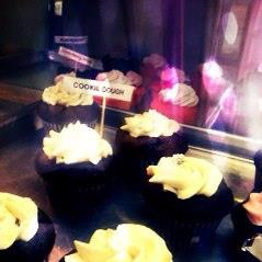 Creme de la Creme offers a variety of cupcakes, all on display for customers to pick and choose.