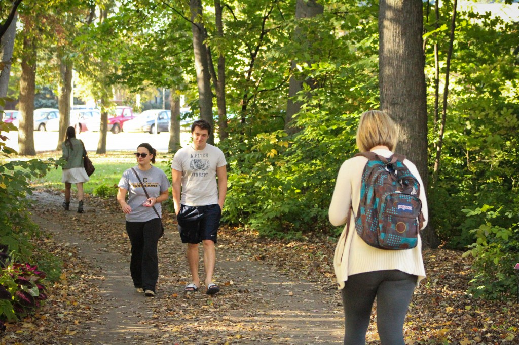 "Amanda Gates (left), a junior said she walks because it has been gorgeous out lately so it is nice to walk. Junior, Colin Whitney said, ""I walk because walking is easier than finding a parking spot and paying for a meter."" (Photo 