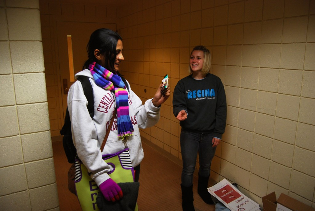 Becky Burtka passes out Luna Bars and other healthy foods to students who take the stairs instead of the elevator in Dow Science Complex on the campus of Central Michigan University on Friday, Nov. 8, 2013. On some days, Burtka passes out more than 150 Luna Bars to students in the stair cases.
