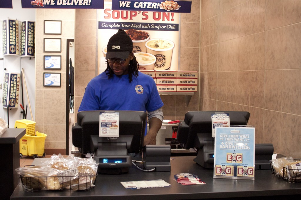 Andarius Taylor, Central Michigan University alumni rings a customer up at Erbert & Gerbert's Sandwich Shop. (Photo | Shannon Millard)