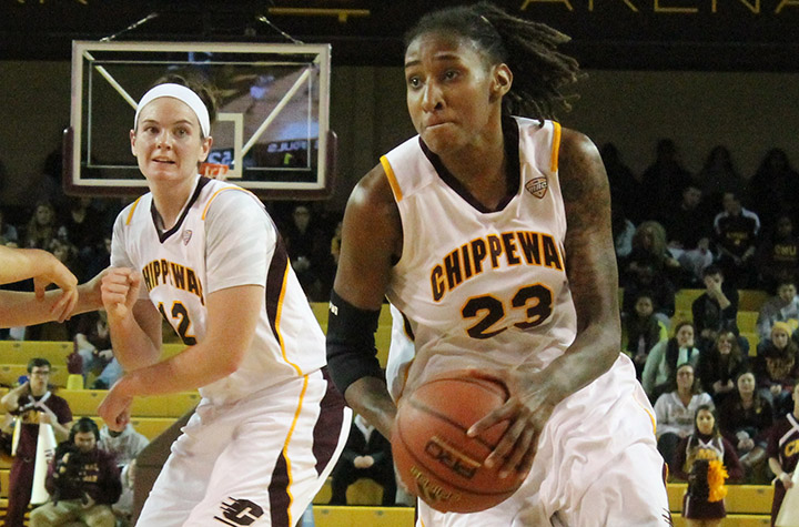 Crystal Bradford drives the lane against Dayton at McGuirk Arena on Dec. 5, 2013. (Photo | Brittni Hengesbach)