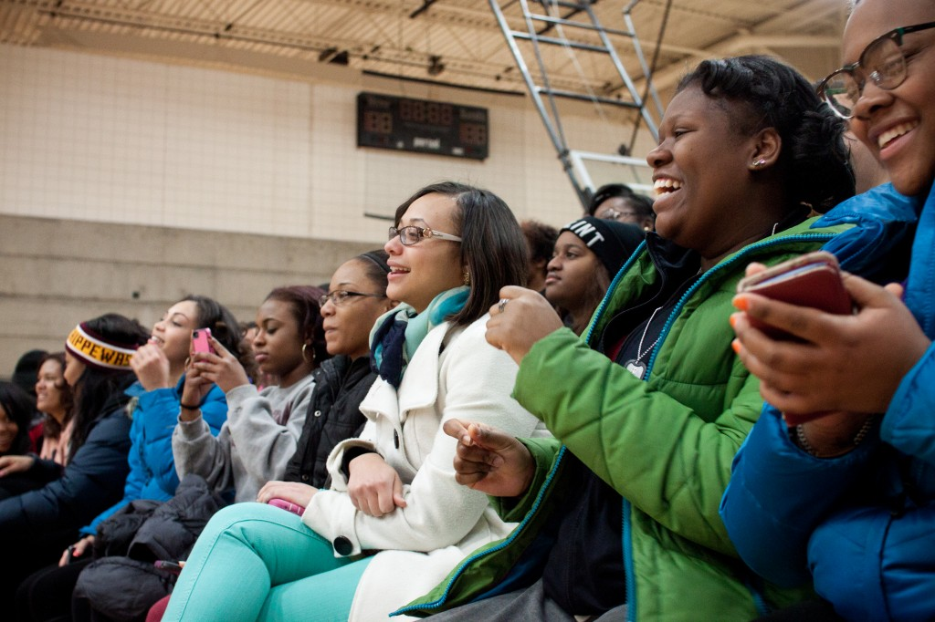 Cabrina Felton a freshman at Central Michigan University dances as she listens to Fish N Chips perform at  the MLK charity basketball game. (Photo | Shannon Millard)