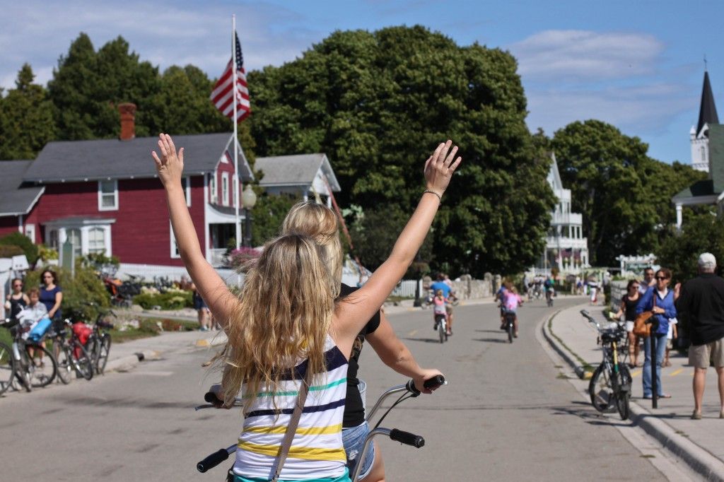 Central Michigan University Junior, Kendra Flaugher and Kaitlyn Millard take a ride around Mackinac Island on a tandem bicycle. August 20, 2012. (Photo | Shannon Millard)