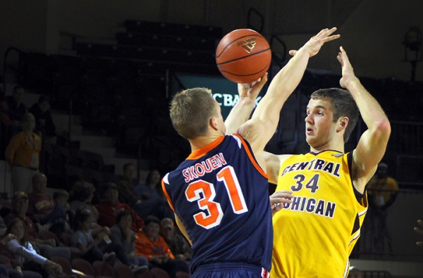 John Simons blocks a shot against Kent State at McGuirk Arena on Feb. 5, 2014. (Photo | Christopher Holman)