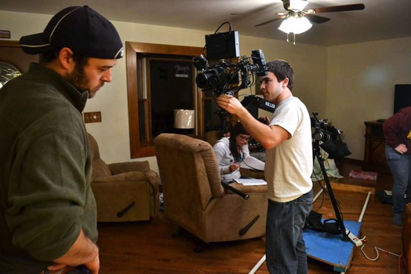 """Dave Giles (Left), Grant Pichla (Right) and Lindsay Chestnut (Back) prepare to film on the set of Pichla's debut film, """"Niner."""""""
