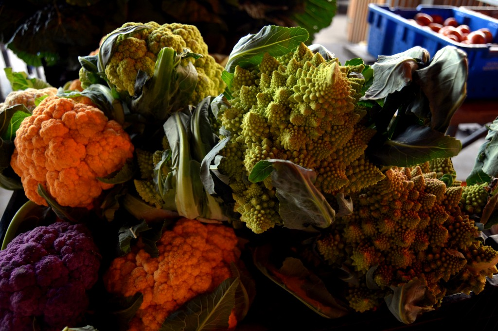 Isaac Martin offers three types of cauliflower - purple, orange, and green - and another oddity, the romanesco, a combination of broccoli and cauliflower, at the Mount Pleasant Farmers' Market on Saturday, Sept. 25, 2014. (Photo | Andrea Henk)