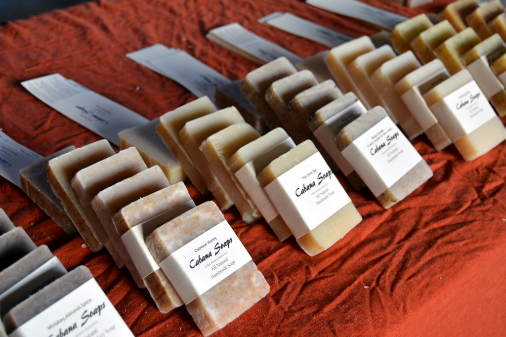 The creator of Cabana Soaps, a business from Midland, Mich., sells homemade soaps made from interesting ingredients including vodka and sand on the morning of Sept. 25, 2014 at the Mount Pleasant Farmers' Market. (Photo | Andrea Henk)
