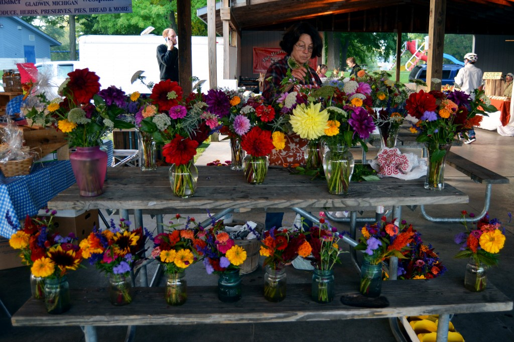 Deanna Methner sells flower arrangements on the morning of Sept. 25, 2014 at the Mount Pleasant Farmers' Market. The flowers come from her own home garden and although she doesn't have a shop, she does bridal arrangements and more. (Photo | Andrea Henk)