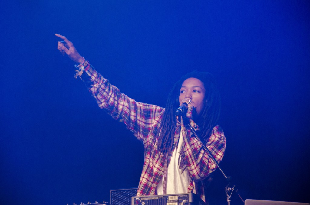 DJ Osh Kosh, Two-9's only female member, points to the crowd. (Photo | Claire Abendroth)