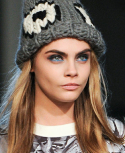 Model Cara D. in Giles fashion show wearing bright blue eyeliner