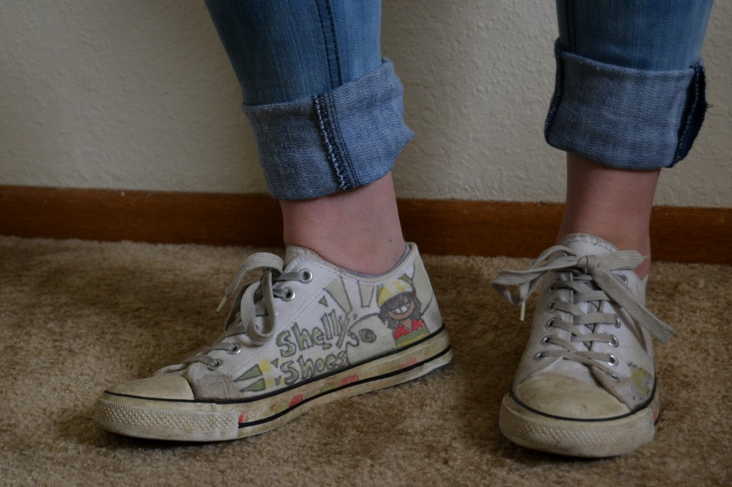 "Brianna Clippert bought these white tennis shoes at Meijer almost six years ago. ""They may have been cheap but they are still wearable,"" Brianna said. Her friend, Shelly, drew pictures on them a while back."