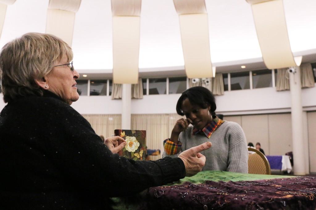 Lauren Lynn has a reading with psychic Pam Sekula during her reading at CMU Program Board's Psychic Fair on Thursday January 15, 2015. (Photo I Kaiti Chritz)