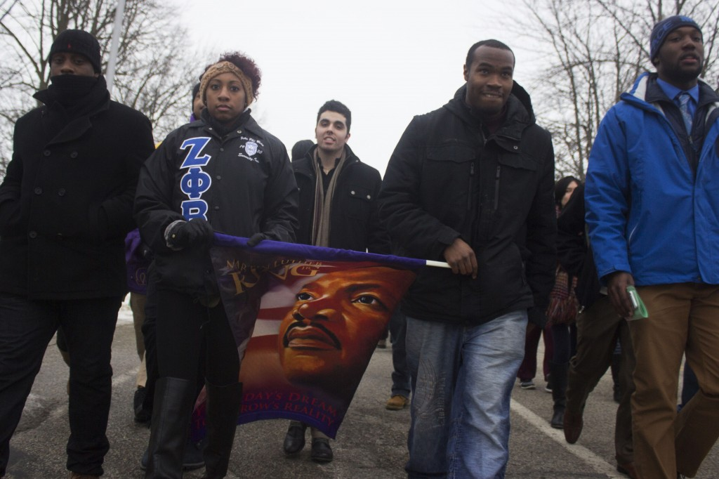 Central Michigan University students and Mount Pleasant community members march at the Dr. Martin Luther King Jr. Peace March and Vigil on January 19, 2015. (Photo I Max Barth)