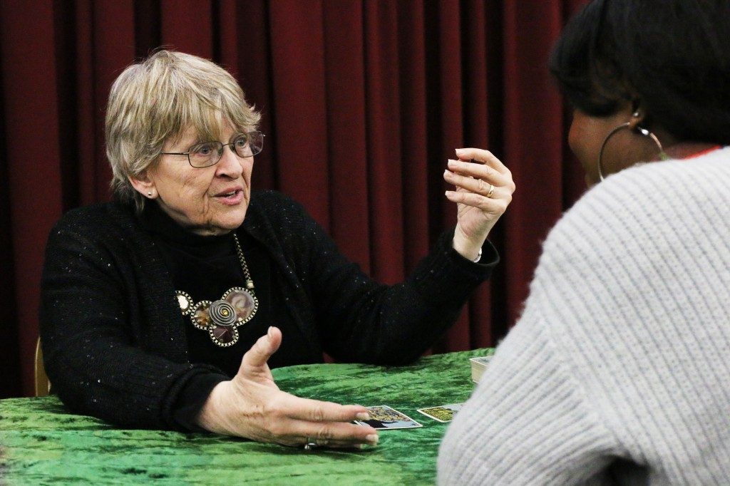 Psychic Pam Sekula reads tarot cards to a student at CMU Program Board's Psychic Fair on Thursday January 15, 2015. (Photo I Kaiti Chritz)