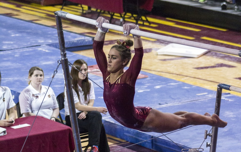 Taylor Bolender competes in the Uneven Bars during a meet against NIU in McGuirk Arena, on the campus of Central Michigan University, Mount Pleasant, Michigan, Friday, February 6, 2015. (Photo I Rich Drummond)