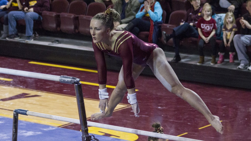 Megan Lamphere competes in the uneven bars during a match against NIU in McGuirk Arena, on the campus of Central Michigan University, Mount Pleasant, Michigan, Friday, February 6, 2015. (Photo I Rich Drummond)