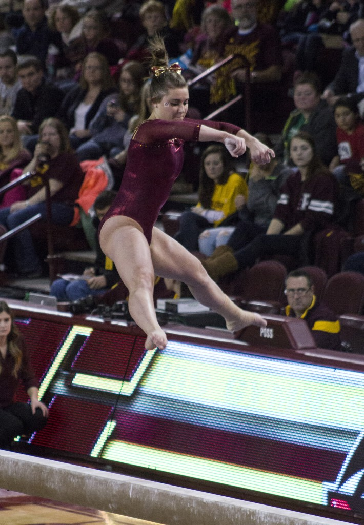 Miranda Wieczorek competes on the balance beam during a match against NIU in McGuirk Arena, on the campus of Central Michigan University, Mount Pleasant, Michigan, Friday, February 6, 2015. (Photo I Rich Drummond)