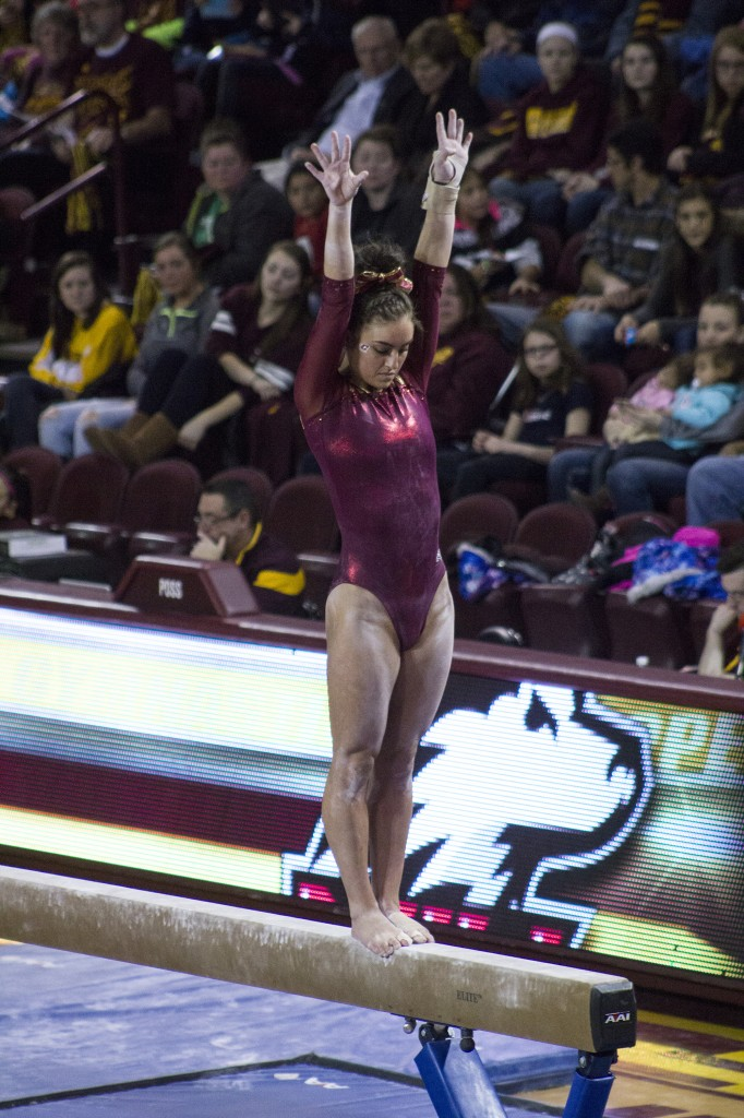 Taylor Bolender competes on the balance beam during a match against NIU in McGuirk Arena, on the campus of Central Michigan University, Mount Pleasant, Michigan, Friday, February 6, 2015. (Photo I Rich Drummond)