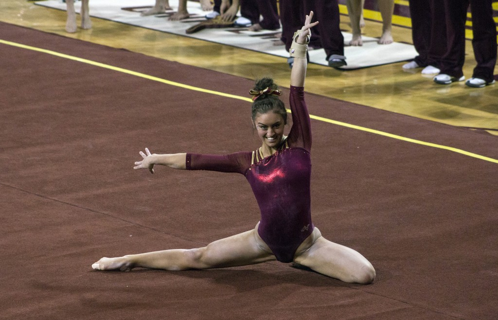 Taylor Bolender competes in the floor exercise during a meet against NIU in McGuirk Arena, on the campus of Central Michigan University, Mount Pleasant, Michigan, Friday, February 6, 2015. (Photo I Rich Drummond)