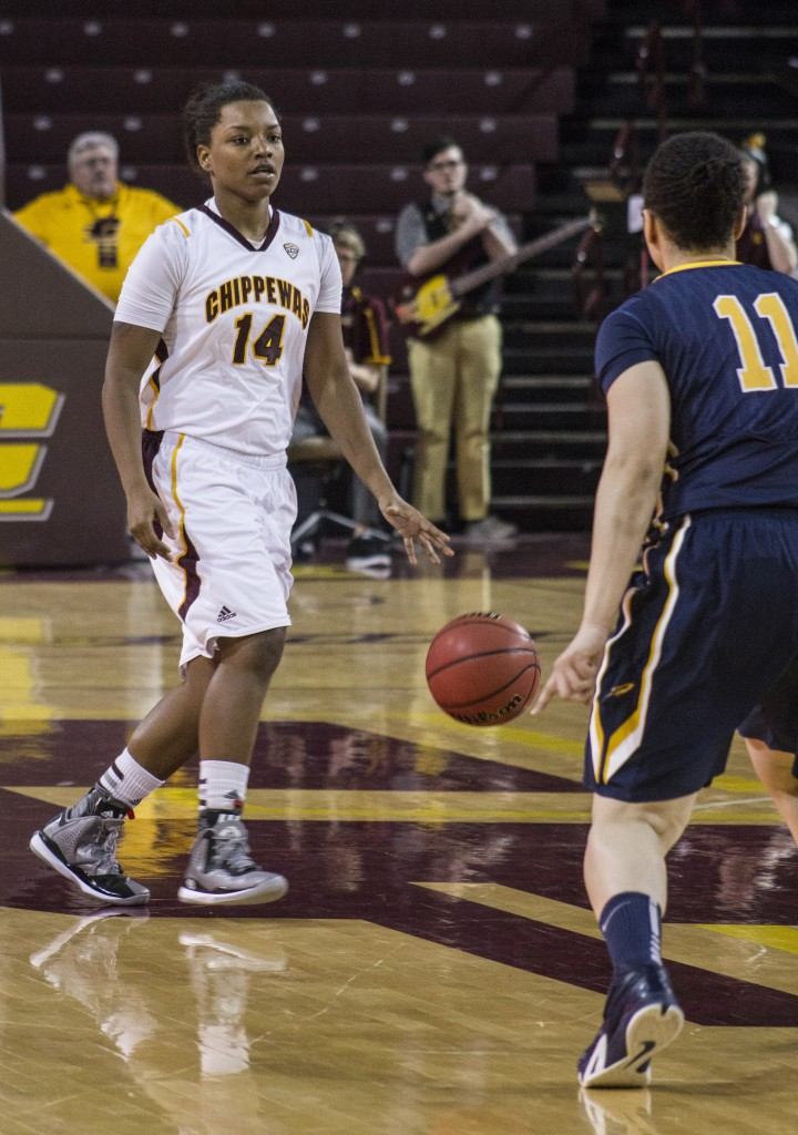 Central Michigan's Amani Corely (14) dribbles the ball up the court against Toledo's Jay-Ann Bravo-Harriott (11) in McGuirk Arena, on the campus of Central Michigan University, Mount Pleasant, Michigan, Wednesday, February 11, 2015. (Photo I Rich Drummond)