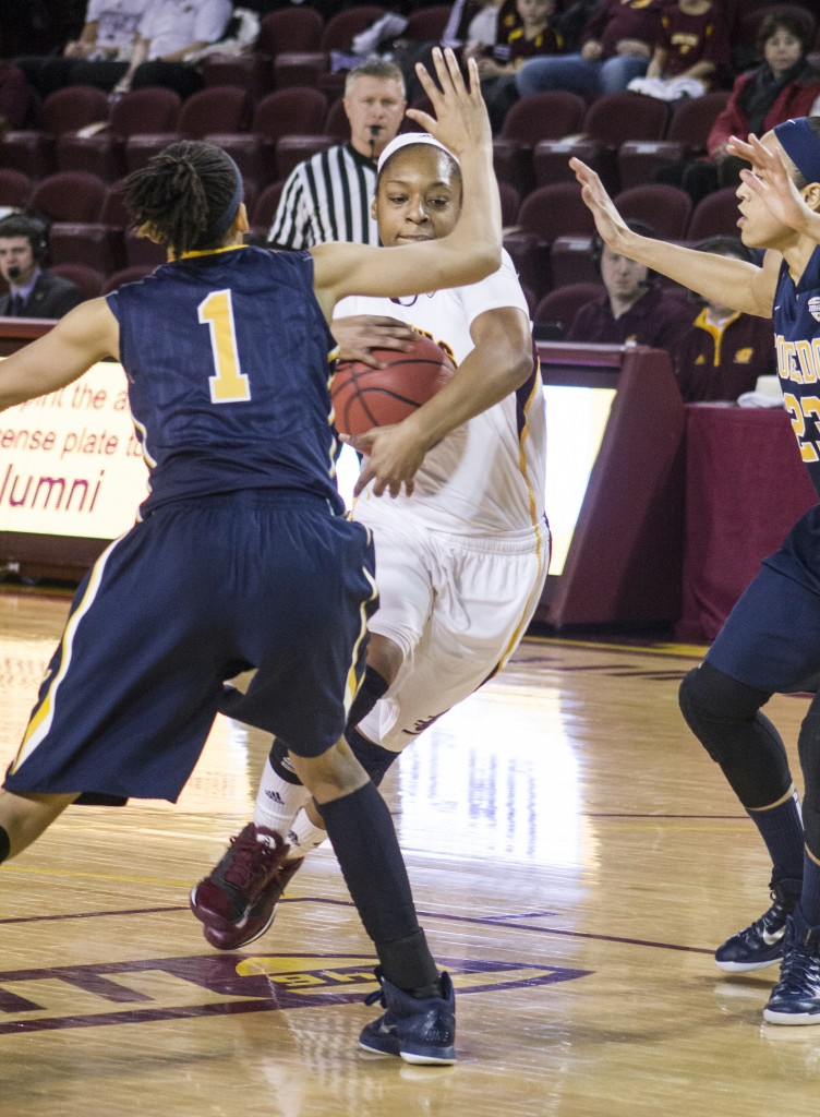 Central Michigan's Da'Jourie Turner, (1), drives the lane against Toledo's Brenae Harris, (1), and Inma Zanoguera,(23),  in McGuirk Arena, on the campus of Central Michigan University, Mount Pleasant, Michigan, Wednesday, February 11, 2015. (Photo I Rich Drummond)
