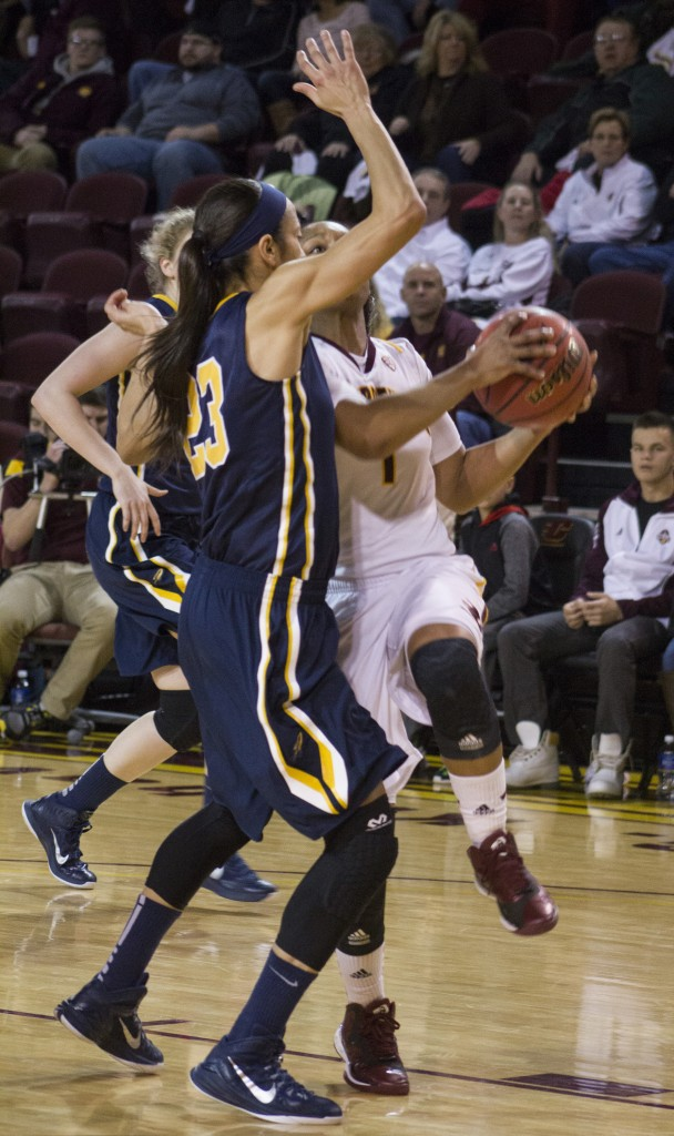 Central Michigan's Da'Jourie Turner (1) goes up for a lay up against Toledo's Inma Zanoguera (23) in McGuirk Arena, on the campus of Central Michigan University, Mount Pleasant, Michigan, Wednesday, February 11, 2015. (Photo I Rich Drummond)