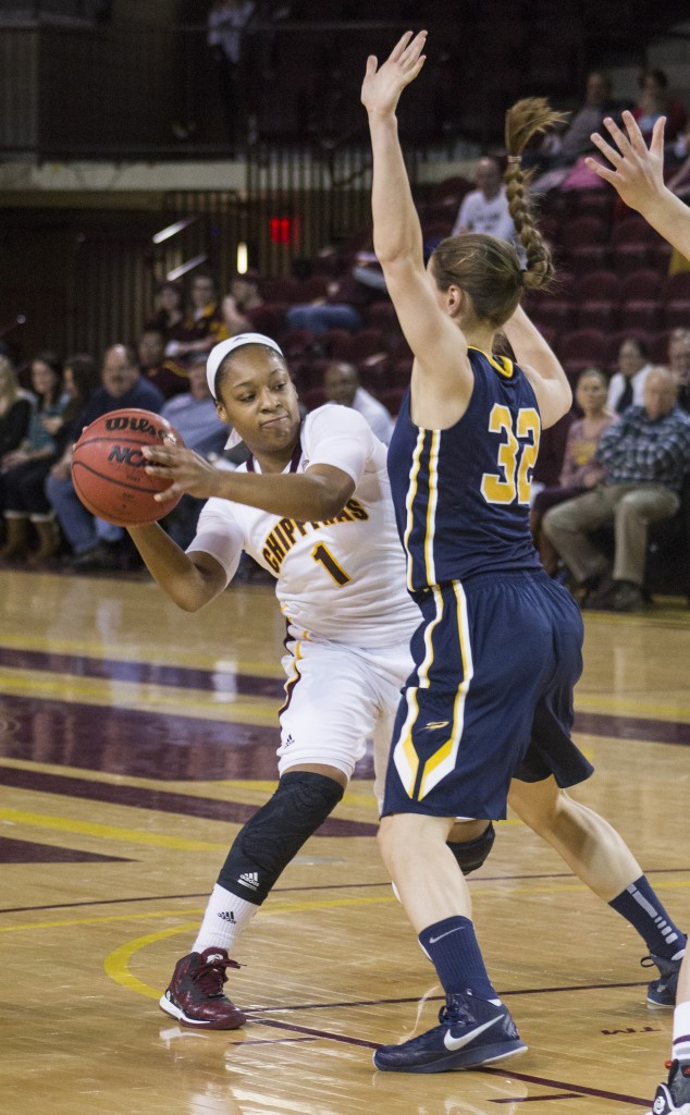 Central Michigan's Da'Jourie Turner (1) is defended by Toledo's Ana Capotosto (32  in McGuirk Arena, on the campus of Central Michigan University, Mount Pleasant, Michigan, Wednesday, February 11, 2015. (Photo I Rich Drummond)