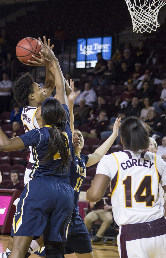 Central Michigan's Lorreal Jones (2) attempts a runner against Toledo's Janice Monakana (12) in McGuirk Arena, on the campus of Central Michigan University, Mount Pleasant, Michigan, Wednesday, February 11, 2015. (Photo I Rich Drummond)