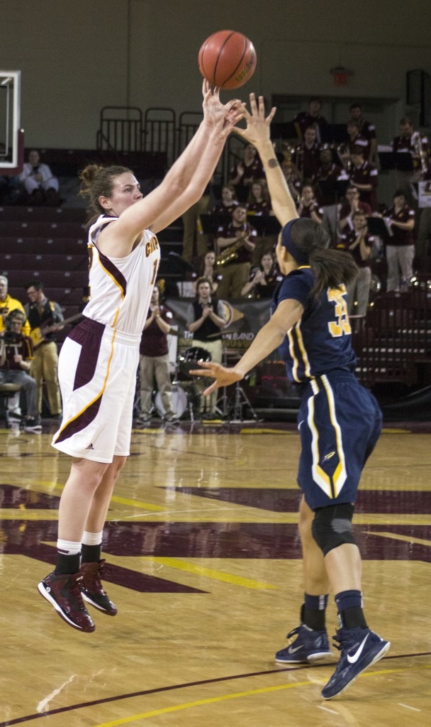Central Michigan's Kerby Tamm, (12), attempts a jumper against Toledo's Jada Woody, (35), in McGuirk Arena, on the campus of Central Michigan University, Mount Pleasant, Michigan, Wednesday, February 11, 2015. (Photo I Rich Drummond)