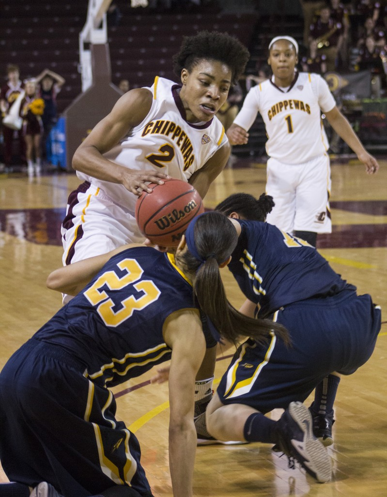 Central Michigan's Lorreal Jones (2) fights for the ball against two TOldeo players in McGuirk Arena, on the campus of Central Michigan University, Mount Pleasant, Michigan, Wednesday, February 11, 2015. (Photo I Rich Drummond)