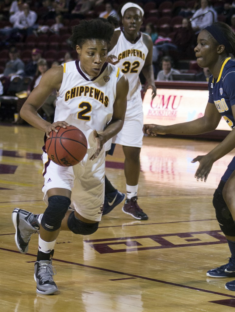 Central Michigan's Lorreal Jones, (2), drives the lane against Toledo's Janice Monakana, (12), in McGuirk Arena, on the campus of Central Michigan University, Mount Pleasant, Michigan, Wednesday, February 11, 2015. (Photo I Rich Drummond)