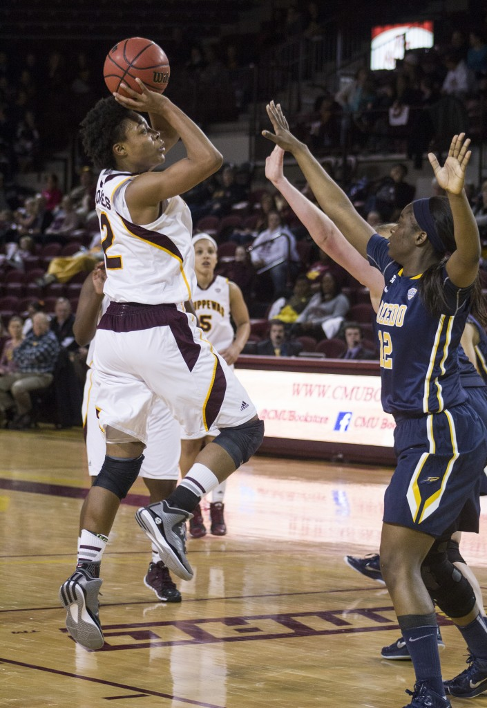 Central Michigan's Lorreal Jones (2) throws up a fadeaway shot against Toledo's Janice Monakana (12)  in McGuirk Arena, on the campus of Central Michigan University, Mount Pleasant, Michigan, Wednesday, February 11, 2015. (Photo I Rich Drummond)