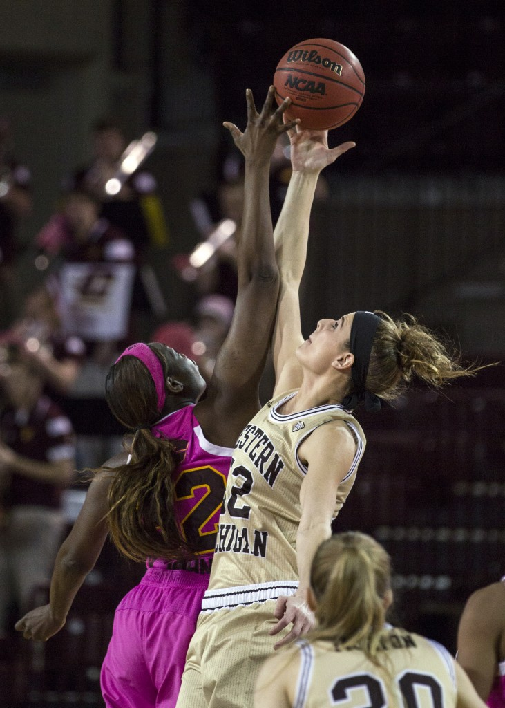 Central Michigan's Jas'Mine Bracey, (32), goes up during the opening tip agaisnt Western Michigan's Jessica Jessing, (52), during their game in McGuirk Arena, on the campus of Central Michigan University, Mt. Pleasant, Michigan, Saturday, February 21, 2015