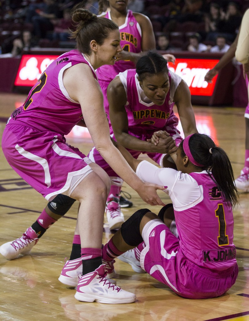 Central Michigan's Da'Jourie Turner, (1), is helped up by her teammates during their game against Western Michigan in McGuirk Arena, on the campus of Central Michigan University, Mt. Pleasant, Michigan, Saturday, February 21, 2015