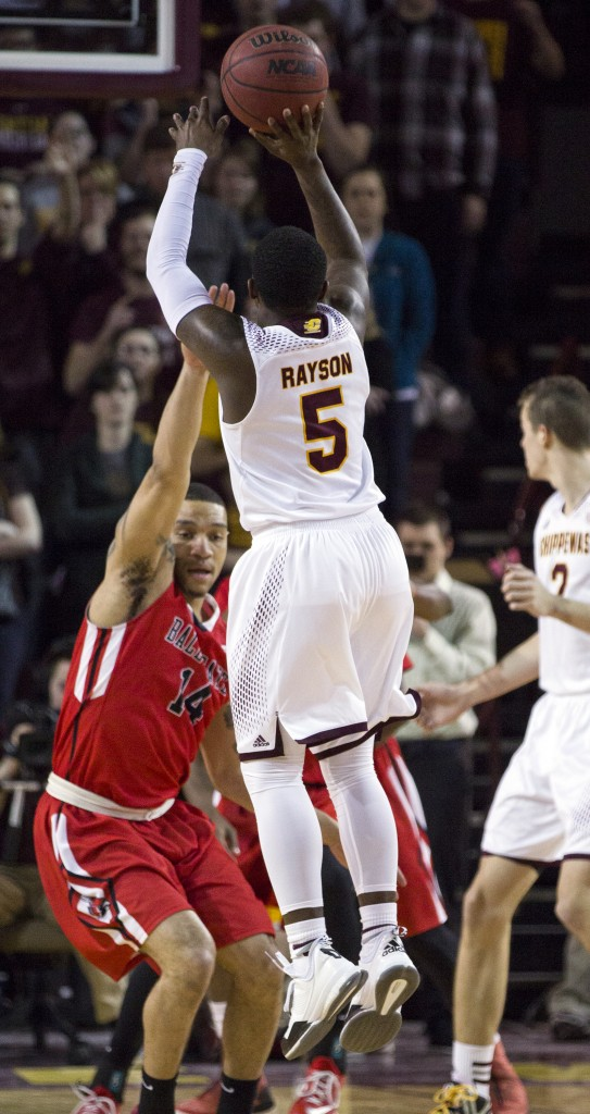 Central Michigan's Braylon Rayson, (5), takes a jumper against Ball State's Jeremiah Davis, (14), during their game in McGuirk Arena, on the campus of Central Michigan University, Mt. Pleasant, Michigan, Saturday, February 21, 2015