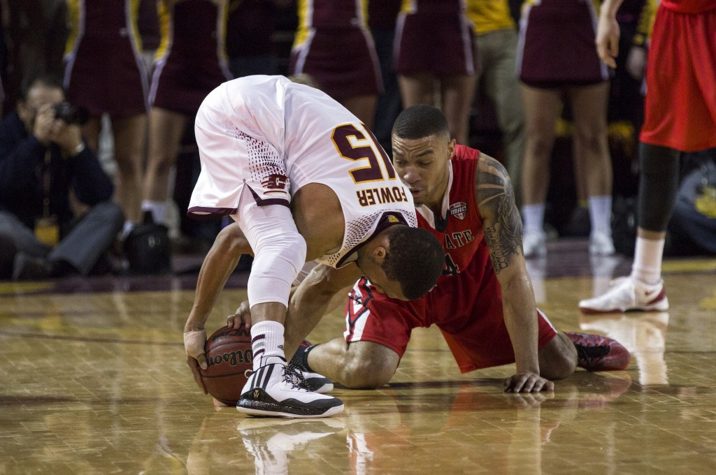 Central Michigan's Chris Fowler, (15), battles for the ball against Ball State's Jeremiah Davis, (14), during their game in McGuirk Arena, on the campus of Central Michigan University, Mt. Pleasant, Michigan, Saturday, February 21, 2015