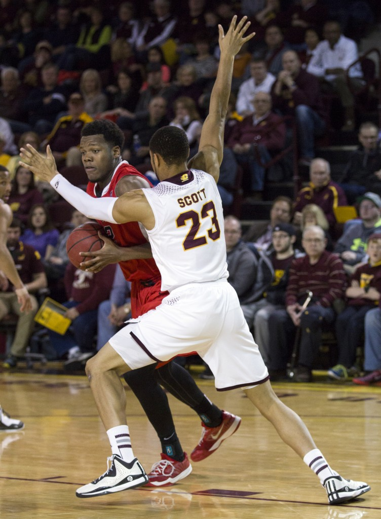 Central Michigan's DaRohn Scott, (23), defends Ball State's Bo Calhoun, (12), during their game in McGuirk Arena, on the campus of Central Michigan University, Mt. Pleasant, Michigan, Saturday, February 21, 2015