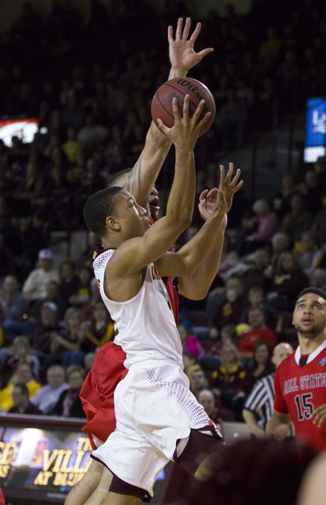 Central Michigan's Rayshawn Simmons, (4), goes up for a lay up against Ball State's Jeremiah Davis, (14), during their game in McGuirk Arena, on the campus of Central Michigan University, Mt. Pleasant, Michigan, Saturday, February 21, 2015