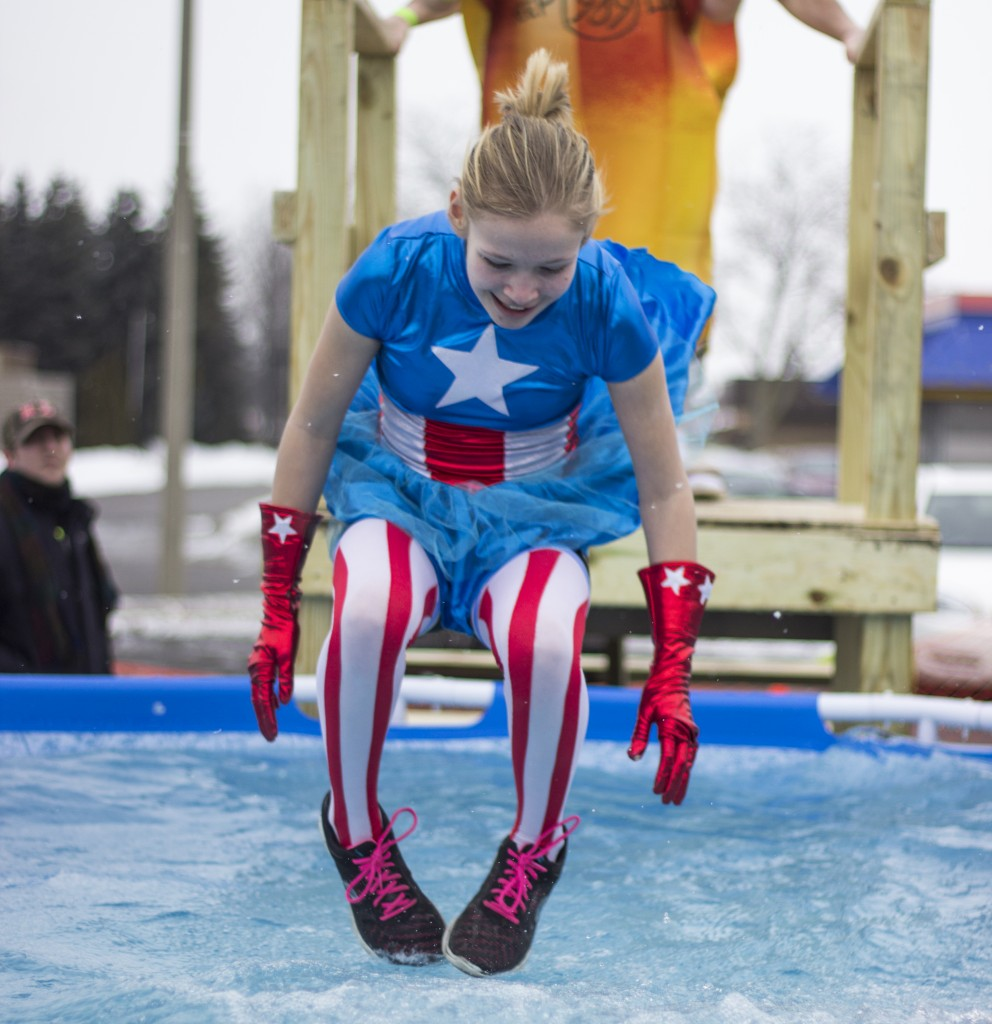 A woman dressed as Captain America jumped into the cold water for the Mount Pleasant Polar Plunge. (Photo | Max Barth)