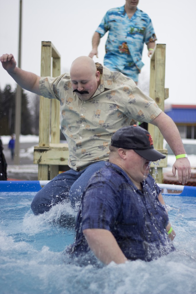 Participants of the Mount Pleasant Polar Plunge jump one after another into the cold water. (Photo | Max Barth)