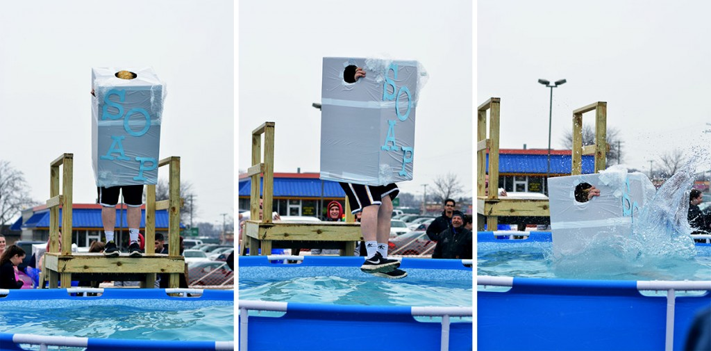 A man in a soap costume jumps into the freezing water during the Mount Pleasant Polar Plunge. (Photo | Andrea Henk)