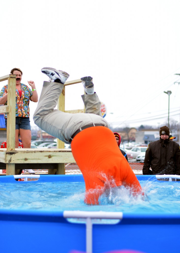 A Mount Pleasant Polar Plunge participant dives into the pool head first. (Photo | Andrea Henk)