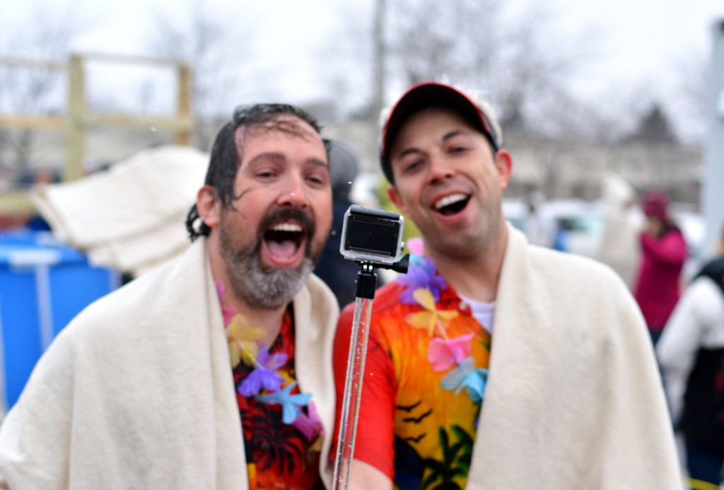 Two participants of the Mount Pleasant Polar Plunge shout excitedly into their go-pro after jumping into the cold pool. (Photo | Andrea Henk)