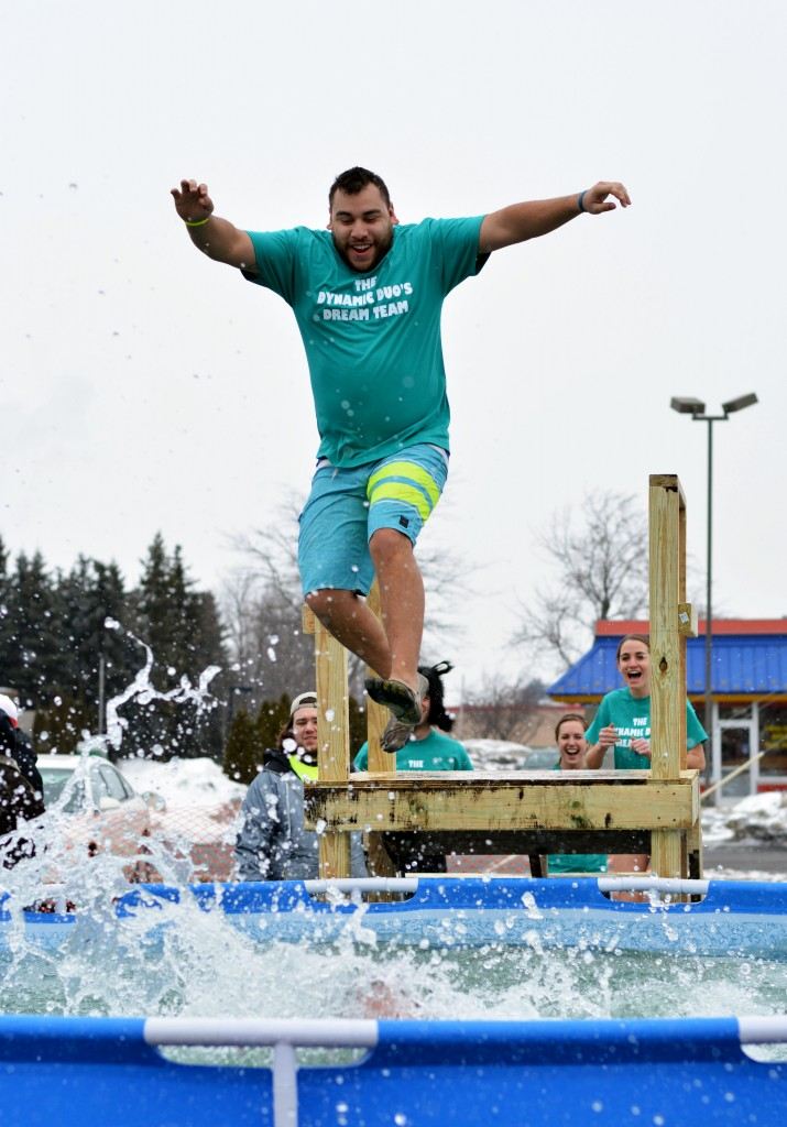 A Mount Pleasant Polar Plunge Participant takes a great leap into the pool. (Photo | Andrea Henk)