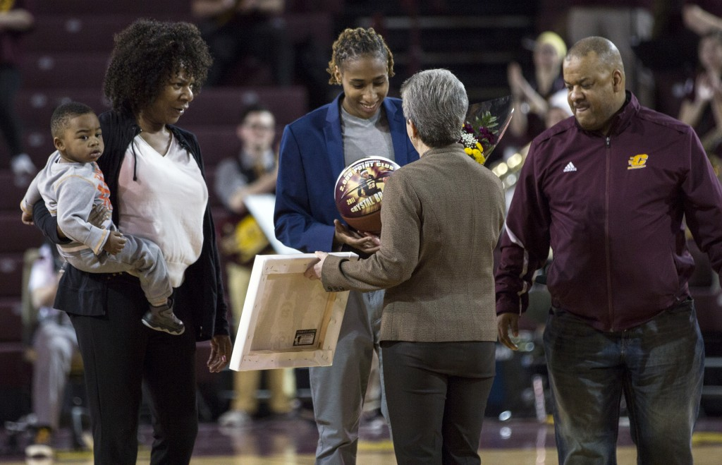 Central Michigan's Crystal Bradford accepts her plaque and basketball from coach Sue Guevara before their game against Eastern Michigan at McGuirk Arena, on the campus of Central Michigan University, Mt. Pleasant, Michigan, Saturday, March 7, 2015.  (Photo I Rich Drummond)