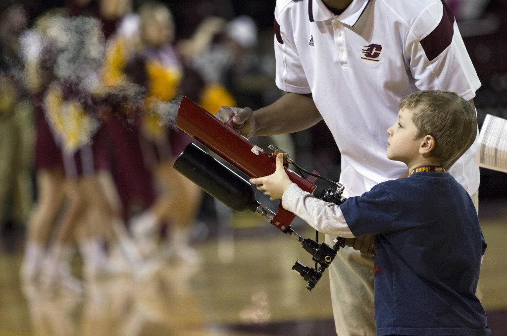 A young Central Michigan fan fires off the t-shirt cannon into the crowd during a timeout at McGuirk Arena. (Photo I Rich Drummond)
