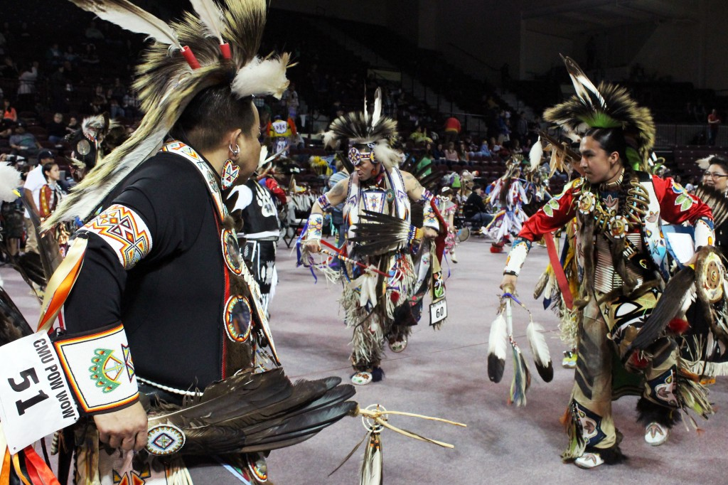 Dancers gather around McGuirk Arena and the 26th Annual Celebrating Life Pow wow in regalia. (Photo I Julie Frederick)