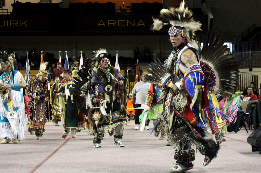 Shane Mitchell (right) performs the traditional dance at the 26th Annual Pow wow at the McGuirk Arena. Shane is from Lac du Flambeau, Wisconsin, and is part of the Ojibwe society.(Photo I Julie Frederick)