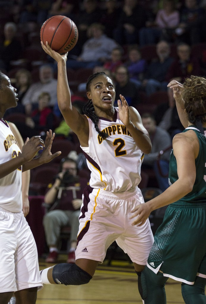 Central Michigan's Lorreal Jones, (2), puts up a floater against Eastern Michigan's Brianna Puni, right, during their game at McGuirk Arena. (Photo I Rich Drummond)