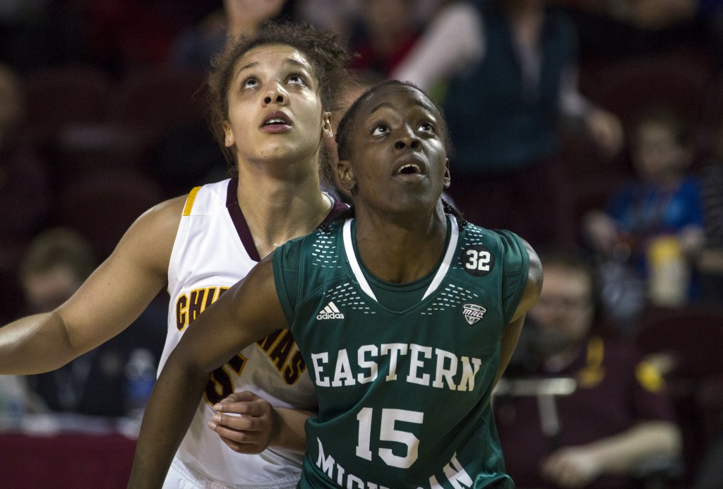Central Michigan's Aleah Swary, (5), is boxed out by Eastern Michigan's Jamaica Bucknor, (15). (Photo I Rich Drummond)